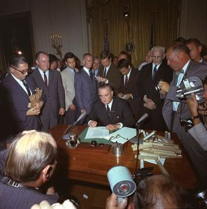 President Lyndon B. Johnson signs Civil Rights Act, July 2, 1964. (Image: Wikimedia Commons)
